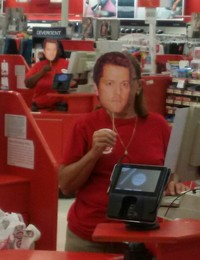 #25 Get all of the checkout employees at a supermarket to wear ''Mishacolypse'' masks as they ring up customers. They all must be working their individual registers when you take the picture. There must be a minimum of four checkout workers. The more cashiers, the more points.